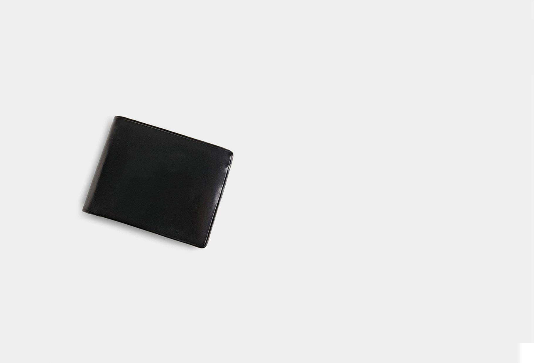 IL BUSSETTO / Bi-fold wallet with snap Black